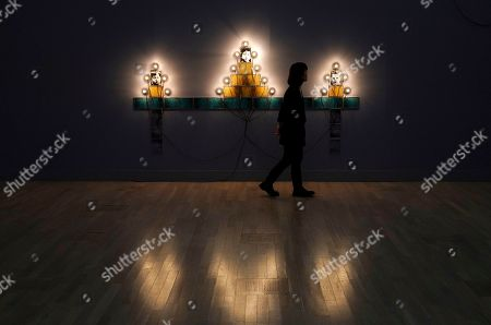 A visitor walks past the artwork 'Monument' by French artist Christian Boltanski during the press preview of the 'Christian Boltanski - Lifetime' exhibition at the National Art Center in Tokyo, Japan, 11 June 2019. The exhibition presents almost 50 artworks by the artist and will be open to the public from 12 June to 02 September 2019.