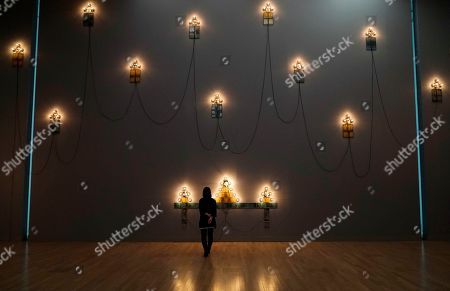 A visitor looks at artworks by French artist Christian Boltanski during the press preview of the 'Christian Boltanski - Lifetime' exhibition at the National Art Center in Tokyo, Japan, 11 June 2019. The exhibition presents almost 50 artworks by the artist and will be open to the public from 12 June to 02 September 2019.