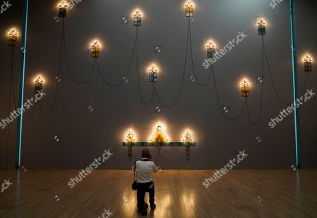 A visitor takes pictures of artworks by French artist Christian Boltanski during the press preview of the 'Christian Boltanski - Lifetime' exhibition at the National Art Center in Tokyo, Japan, 11 June 2019. The exhibition presents almost 50 artworks by the artist and will be open to the public from 12 June to 02 September 2019.