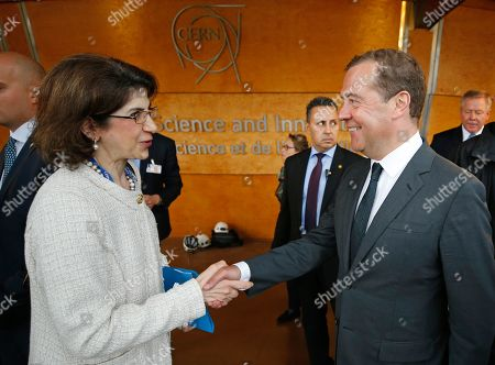 Russian Prime Minister Dmitry Medvedev (R) and CERN (European Council for Nuclear Research) director general Fabiola Gianotti (L) shake hands during their meeting at the CERN in Geneva, Switzerland, 10 June 2019 (issued 11 June 2019).