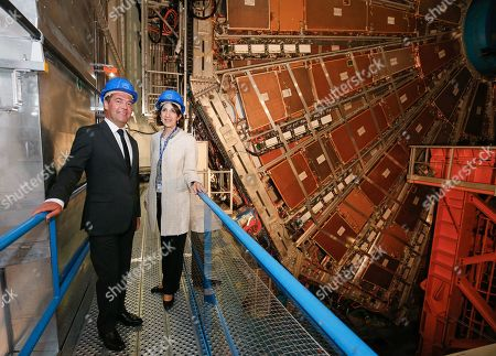 Stock Picture of Russian Prime Minister Dmitry Medvedev (L) and CERN (European Council for Nuclear Research) director general Fabiola Gianotti (R) stand next to ATLAS detector at the Large Hadron Collider (LHC) at the CERN in Geneva, Switzerland, 10 June 2019 (issued 11 June 2019).