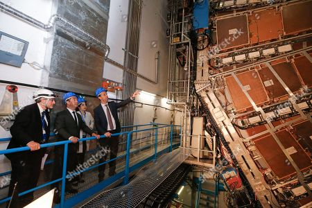 Stock Image of Russian Prime Minister Dmitry Medvedev (2-L) and CERN (European Council for Nuclear Research) director general Fabiola Gianotti (2-R) look on the ATLAS detector at the Large Hadron Collider (LHC) at the CERN in Geneva, Switzerland, 10 June 2019 (issued 11 June 2019).