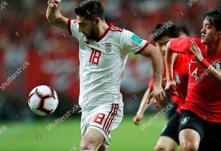 Ehsan Hajsafi (L) of Iran in action against Hong Chul (R) of South Korea during the International Friendly soccer match between South Korea and Iran at the Seoul World Cup Stadium in Seoul, South Korea, 11 June 2019.