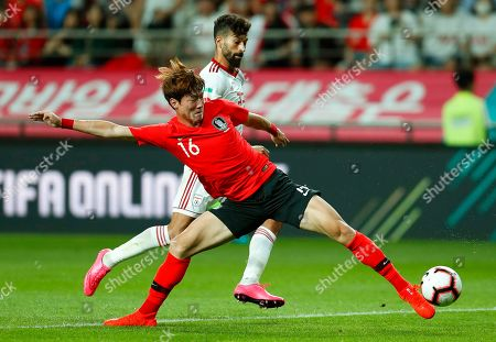 Hwang Ji-jo (front) of South Korea in action against Ramin Rezaeian (back) of Iranduring the International Friendly soccer match between South Korea and Iran at the Seoul World Cup Stadium in Seoul, South Korea, 11 June 2019.