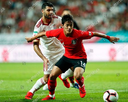 Hong Chul (R) of South Korea in action against Vahid Amiri (L) of Iran during the International Friendly soccer match between South Korea and Iran at the Seoul World Cup Stadium in Seoul, South Korea, 11 June 2019.