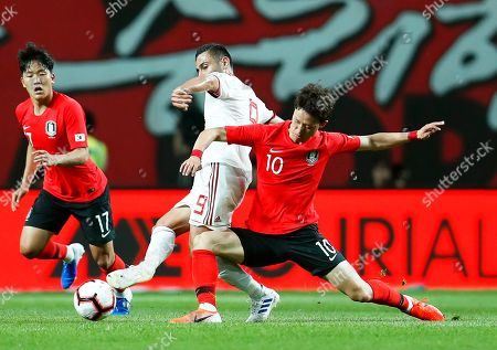 Stock Photo of Milad Mohammadi (C) of Iran in action against Lee Jae-sung (R) of South Korea during the International Friendly soccer match between South Korea and Iran at the Seoul World Cup Stadium in Seoul, South Korea, 11 June 2019.