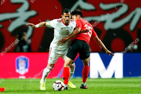 Ehsan Hajsafi (L) of Iran in action against Paik Seung-ho (R) of South Korea during the International Friendly soccer match between South Korea and Iran at the Seoul World Cup Stadium in Seoul, South Korea, 11 June 2019.