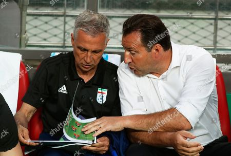 Stock Photo of Iran's head coach Marc Wilmots (R) takes his seat before the International Friendly soccer match between South Korea and Iran at the Seoul World Cup Stadium in Seoul, South Korea, 11 June 2019.