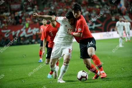 Alireza Jahanbakhsh, Hong Chul. Iran's Alireza Jahanbakhsh, left, fights for the ball against South Korea's Hong Chul during their friendly soccer match in Seoul, South Korea