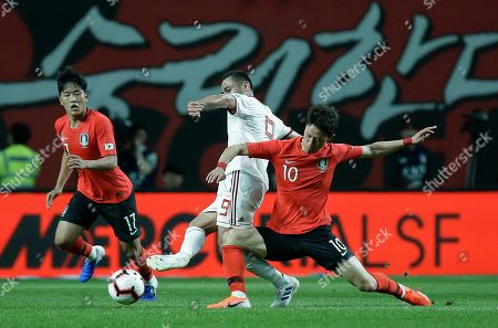 Omid Ebrahimi, Lee Jae-sung. Iran's Omid Ebrahimi against South Korea's Lee Jae-sung, right, during their friendly soccer match in Seoul, South Korea