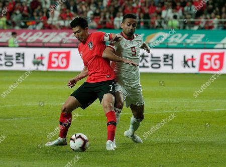 Stock Picture of Son Heung-min, Omid Ebrahimi. South Korea's Son Heung-min, left, fights for the ball against Iran's Omid Ebrahimi during their friendly soccer match in Seoul, South Korea