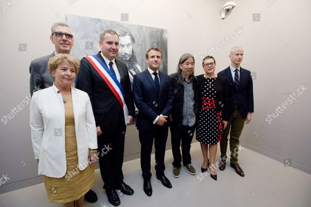 Stock Image of President Emmanuel Macron with Henri Loyrette (curator of the exhibition) and Yan Pei-Ming (painter) with Franck Riester (Minister of Culture), Marie-Guite Dufay (President of the Regional Council of Burgundy-Franche-Comte), Christine Bouquin (President of the departmental council of Doubs), Sylvain Ducret (mayor of Ornans) and Joel Mathurin (prefect of Doubs)