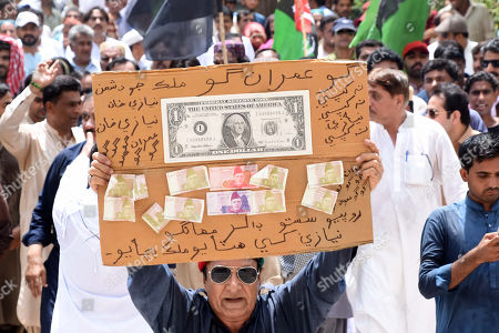 Supporters of opposition party Pakistan Peoples Party hold a placard protesting the economic condition and arrest of party's chairman and former President Asif Ali Zardari by the accountability body NAB, in Larkana, Pakistan, 11 June 2019. Zardari was arrested by NAB after Islamabad High Court on 10 June rejected the extension in bail of Zardari in a case pertaining to the alleged laundering of billions through fake bank accounts.
