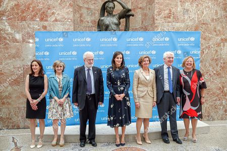 Spain's Queen Letizia (C) poses for a group photo with Spanish Minister of Health, Maria Luisa Carcedo (2L); the President of the Spanish National Research Council, Rosa Menendez (R); the President of Spain Unicef, Gustavo Suarez Pertierra (2R); and laureates Italian Francesco Tonucci (3L), Maria Eulate (L), and Ana Sendagorta (3R) duringthe Spain Unicef Awards handover ceremony held in Madrid, Spain, 11 June 2019.