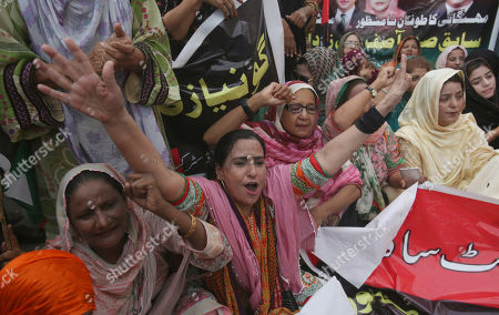 Supporters of Pakistan's People's party protest the arrest of their leader Asif Ali Zardari, in Karachi, Pakistan, . A Pakistani court has handed over former president Zardari to a national anti-graft body for questions regarding a multi-million dollar money laundering case