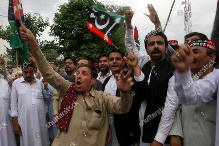 Supporters of Pakistan's People's party protest the arrest of their leader Asif Ali Zardari, in Peshawar, Pakistan, . A Pakistani court has handed over the country's former president Zardari to a national anti-graft body for questions regarding a multi-million dollar money laundering case