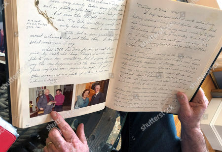 Ryan Cooper displays pages from a 1973 portion of a diary at his home in Yarmouth, Mass., which he wrote when he visited Otto Frank, the father of the famed Holocaust victim and diarist Anne Frank. Cooper is pointing to a photo of him with Otto Frank while holding Anne's original diary. Cooper has donated a trove of letters and mementos he received from Otto Frank to the U.S. Holocaust Memorial Museum ahead of the 90th anniversary of Anne Frank's birthday
