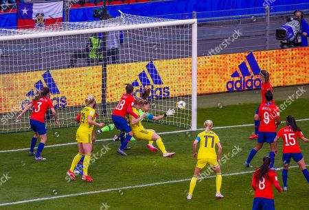 Goalkeeper Christiane Endler of Chile makes a great save from a header by Linda Sembrant of Sweden