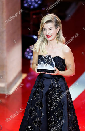 Stock Photo of Polar award winner, German violinist Anne-Sophie Mutter accepts her award during the 2019 Polar music price ceremony at the Grand Hotel in Stockholm, Sweden, 11 June 2019.