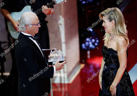 Polar award winner, German violinist Anne-Sophie Mutter (R) accepts her award from King Carl XVI Gustaf of Sweden during the 2019 Polar music price ceremony at the Grand Hotel in Stockholm, Sweden, 11 June 2019.