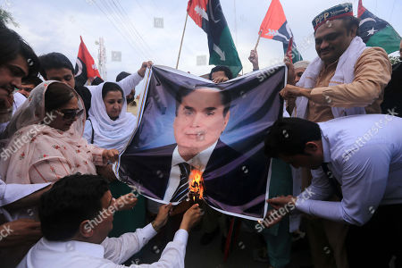 Supporters of opposition party Pakistan Peoples Party shout slogans as they burn a picture of NAB Chairman Javed Iqbal after party's chairman and former President Asif Ali Zardari was arrested by the accountability body NAB, in Peshawar, Pakistan, 11 June 2019. Zardari was arrested by NAB after Islamabad High Court on 10 June rejected the extension in bail of Zardari in a case pertaining to the alleged laundering of billions through fake bank accounts.