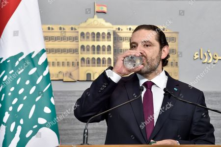 Lebanese Prime Minister Saad Hariri pauses for a drink of water during a news conference at the Government Palace in Beirut, Lebanon, 11 June 2019. Hariri, who returned to Beirut on 11 June 2019 after spending the Eid al-Fitr holiday abroad with his family, was given in response to a spat between his Future Movement and the Free Patriotic Movement, founded by Aoun and now run by his son-in-law Gebran Bassil.