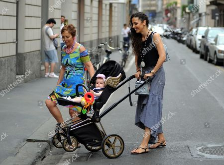 Stock Picture of Laura Barriales shopping with her mother Lucia and daughter Melania