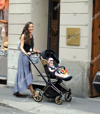 Stock Image of Laura Barriales shopping with her mother Lucia and daughter Melania