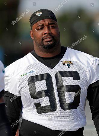 Jacksonville Jaguars defensive lineman Datone Jones walks to the field at an NFL football practice, in Jacksonville, Fla