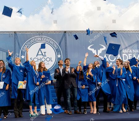 Spanish tennis player Rafa Nadal (C-L) and former player David Ferrer (C-R) attend the graduation ceremony of Rafa Nadal Academy, students of American International School of Mallorca, in Manacor, Balearic Islands, Spain, 11 June 2019.