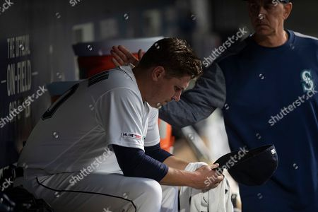 Paul Davis, Erik Swanson. Seattle Mariners starting pitcher Erik Swanson #50 of the Seattle Mariners gets a pat on the back from pitching coach Paul Davis after getting pulled from a baseball game against the Minnesota Twins, in Seattle. The Twins won 11-6