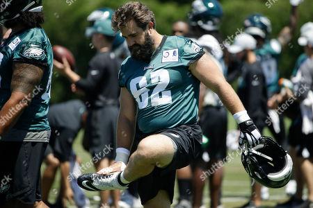 Philadelphia Eagles center Jason Kelce stretches at the NFL football team's practice facility in Philadelphia