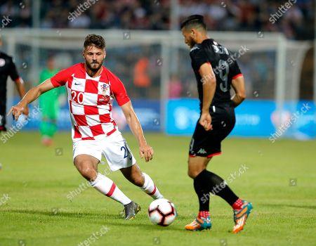 Croatia's Bruno Petkovic (L) in action against Tunisia's Anice Badri (R) during an International friendly soccer match between Croatia and Tunisia in Varazdin, Croatia, 11 June 2019.