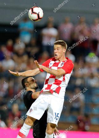 Stock Picture of Croatian Mario Pasalic (R) in action against Tunisia's Ghailene Chaalali (L) during an International friendly soccer match between Croatia and Tunisia in Varazdin, Croatia, 11 June 2019.