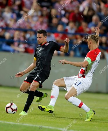 Croatian  Domagoj Vida (R) in action against Tunisia's Youssef Mskani (L) during an International friendly soccer match between Croatia and Tunisia in Varazdin, Croatia, 11 June 2019.