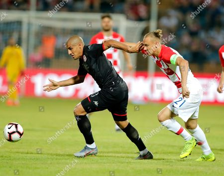 Croatia's Domagoj Vida (R) in action against Tunisia's Wahbi Khazri (L) during an International friendly soccer match between Croatia and Tunisia in Varazdin, Croatia, 11 June 2019.