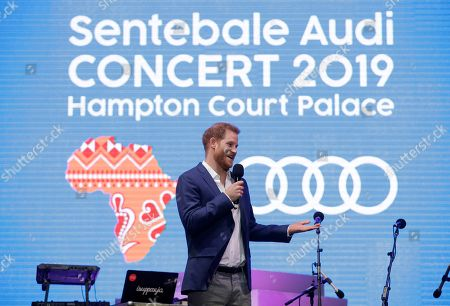 Britain's Prince Harry speaks on stage during a concert hosted by his charity Sentebale at Hampton Court Palace, in London, . The concert will raise funds and awareness for Sentebale, the charity founded by Prince Harry and Lesotho's Prince Seeiso in 2006, to support children and young people affected by HIV and AIDS in Lesotho, Botswana and Malawi