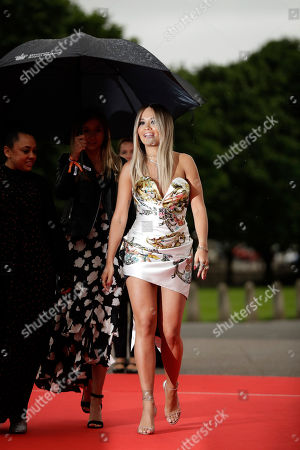 British singer Rita Ora arrives for a concert hosted by the charity Sentebale at Hampton Court Palace, in London, . The concert will raise funds and awareness for Sentebale, the charity founded by Prince Harry and Lesotho's Prince Seeiso in 2006, to support children and young people affected by HIV and AIDS in Lesotho, Botswana and Malawi