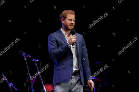 Stock Picture of Britain's Prince Harry speaks on stage during a concert hosted by his charity Sentebale at Hampton Court Palace, in London, . The concert will raise funds and awareness for Sentebale, the charity founded by Prince Harry and Lesotho's Prince Seeiso in 2006, to support children and young people affected by HIV and AIDS in Lesotho, Botswana and Malawi