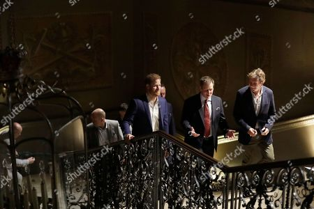 Stock Image of Britain's Prince Harry, left, walks with the Chairman of Sentebale Johnny Hornby, right, after arriving for a concert hosted by his charity Sentebale at Hampton Court Palace, in London, . The concert will raise funds and awareness for Sentebale, the charity founded by Prince Harry and Lesotho's Prince Seeiso in 2006, to support children and young people affected by HIV and AIDS in Lesotho, Botswana and Malawi