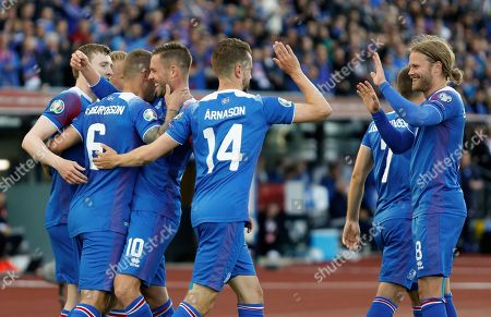 Stock Photo of Iceland Turkey Euro 2020 Soccer. The Icelandic team celebrates Ragnar Sigurdsson's second goal against Turkey, during the Euro 2020 group H qualifying soccer match between Iceland and the Turkey at Laugardalsvollur stadium in Reykjavik, Iceland