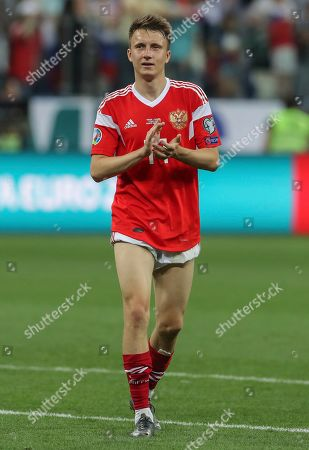 Russia's Aleksandr Golovin applauds after the Euro 2020 group I qualifying soccer match between Russia and Cyprus at the Nizhniy Novgorod Stadium in Nizhniy Novgorod, Russia
