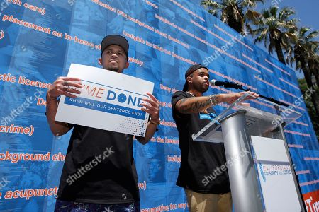 Stock Image of P-Lo, Bobby Brackins. Music artists P-Lo, left, and Bobby Brackins speak in support of legislation that would help automatically expunge old criminal records during rally at the Capitol in Sacramento, Calif., . The nonprofit organizer of the rally, Californians for Safety and Justice, estimates that 1 million Californians could benefit. Behind the pair is a 20-foot-tall, 70-foot-wide exhibit outlining legal restrictions that Americans with the past convictions or criminal records face after they've completed their sentences