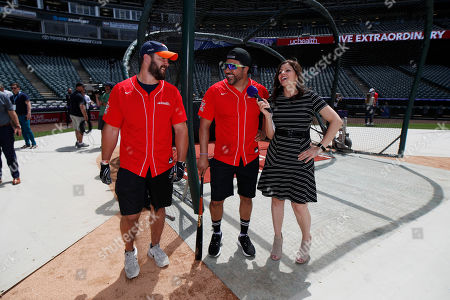 Vinny Castilla, Andy Janovich, Jenny Cavnar, r m. Colorado Rockies television announcer Jenny Cavnar, right, jokes with Vinny Castilla, center, special assistant to the Rockies general manager, and Denver Broncos fullback Andy Janovich after they took part in the UC Healthy Swings Charity Home Run Derby, in Coors Field in Denver. The event was staged to benefit the Leukemia and Lymphoma Society-Rocky Mountain and featured a dozen members of the Denver Broncos
