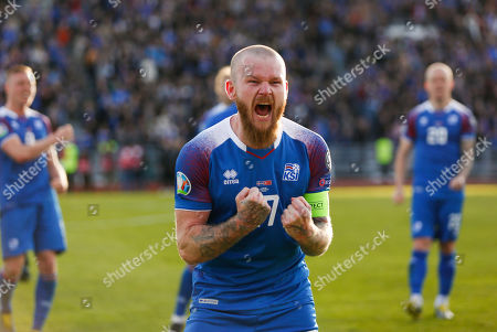 Iceland Turkey Euro 2020 Soccer. Iceland's captain Aron Einar Gunnarsson, celebrates the 2-1 victory against Turkey after the Euro 2020 group H qualifying soccer match between Iceland and the Turkey at Laugardalsvollur stadium in Reykjavik, Iceland