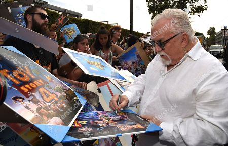 """John Ratzenberger signs autographs as he arrives at the world premiere of """"Toy Story 4"""", at the El Capitan in Los Angeles"""