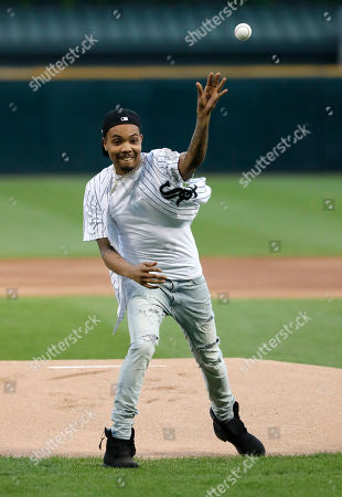 Chicago rapper G Herbo throws a ceremonial first pitch before a baseball game between the Chicago White Sox and the Washington Nationals, in Chicago
