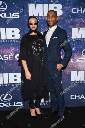 """Executive director of """"Equality for HER"""" Blair Imani, left, and guest attend the world premiere of """"Men in Black: International"""" at the AMC Loews Lincoln Square, in New York. Photo by Evan Agostini/Invision/AP"""