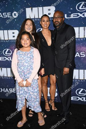 """Inny Clemons, right, and family attend the world premiere of """"Men in Black: International"""" at the AMC Loews Lincoln Square, in New York. Photo by Evan Agostini/Invision/AP"""