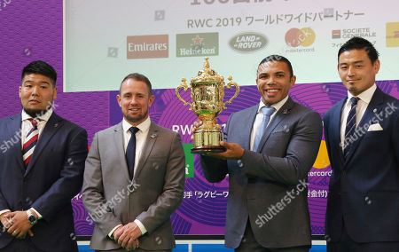 Bryan Habana, Shane Williams. From left; Japanese rugby player Kensuke Hatakeyama, former Wales Shane Williams, South African former rugby union player Bryan Habana, and Japan's player Alum Goromaru pose for photo with the Webb Ellis Cup during a hundred-day countdown event ahead of Rugby World Cup 2019 in Tokyo
